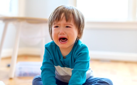 Upset crying and mad little toddler boy Stock fotó