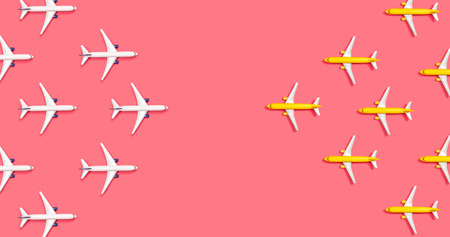 Toy airplanes opposing each other overhead view flat lay