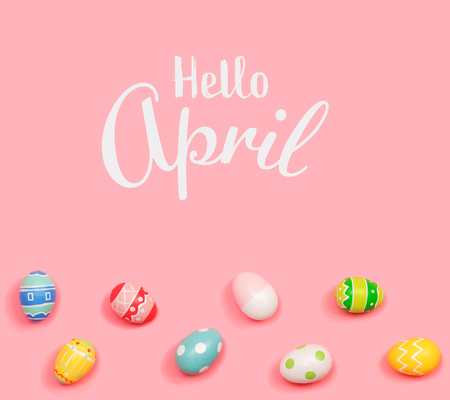 Hello April message with Easter eggs on a pink background