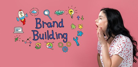 Brand building with young woman speaking on a pink background