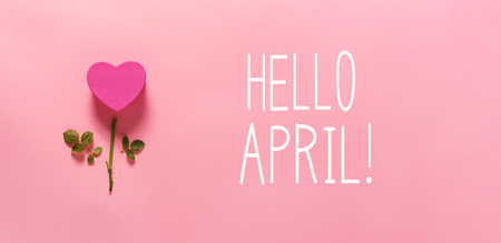 Hello April message with heart flower top view flat lay