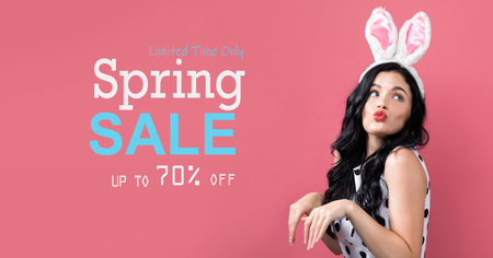Spring sale message with young woman with Easter theme Stock Photo