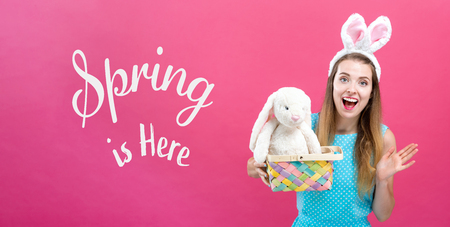 Spring is here message with young woman with Easter basket