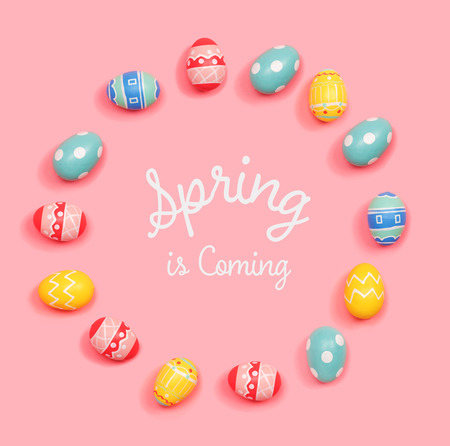 Spring is coming message with round frame of Easter eggs Stock Photo