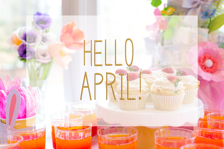 Hello April message with dessert table with cupcakes and flowers