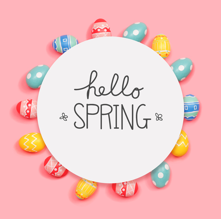 Hello spring message with round frame of Easter eggs Stock Photo