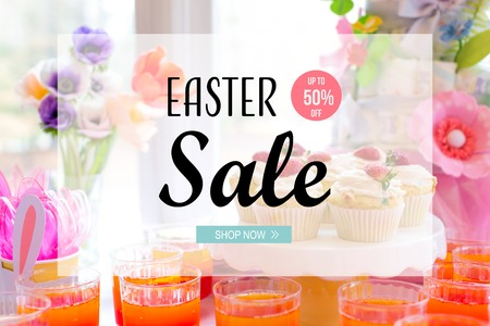 Easter sale message with dessert table with cupcakes and flowers Stock Photo