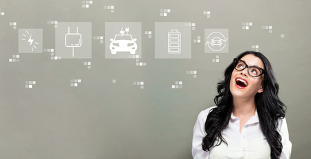 EV with young businesswoman in a thoughtful face Stock Photo