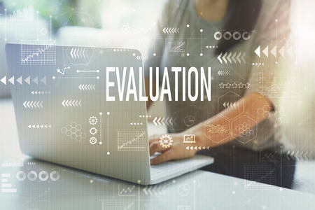 Evaluation with woman using her laptop in her home office Stock Photo