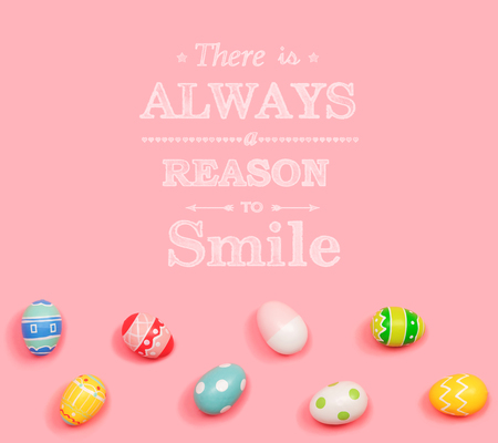There is always a reason to smile with Easter eggs on a pink background Stock Photo