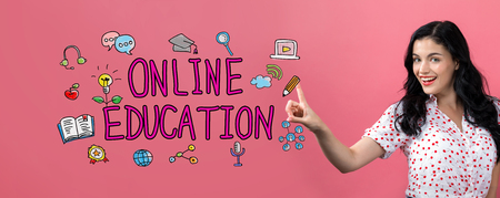 Online education with young woman on a pink background Stock Photo