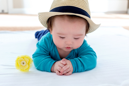 Cute little multi-ethnic baby boy with flowers Stock Photo
