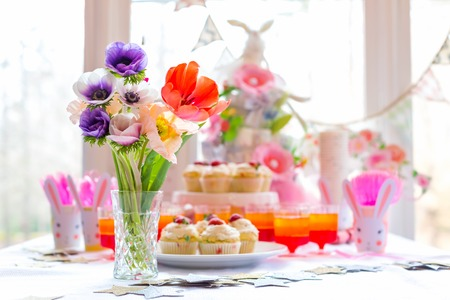 Dessert table with cupcakes and flowers Easter party theme Stock Photo