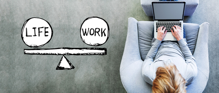 Life and work balance with man using a laptop in a modern gray chair