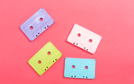Retro cassette tape on a pink paper background