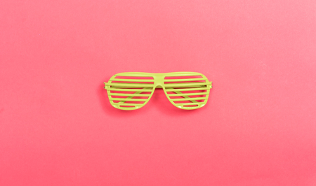 Shutter shade party glasses on a pink paper background Stock Photo