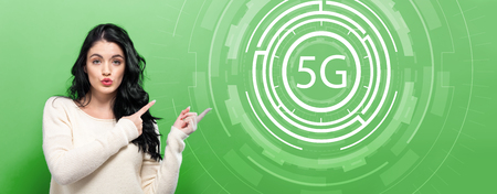 5G network with young woman pointing on a green background