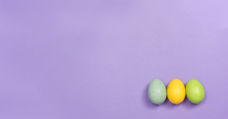 Decorated Easter eggs holiday theme on a purple background Stock Photo