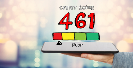 Poor credit score theme with man holding a tablet computer