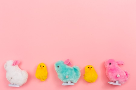 Easter holiday theme with little chick toys on pink background Imagens