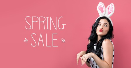 Spring sale message with young woman with Easter theme Imagens