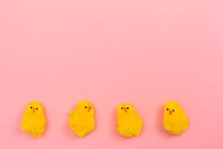 Easter holiday theme with little chick toys on pink background