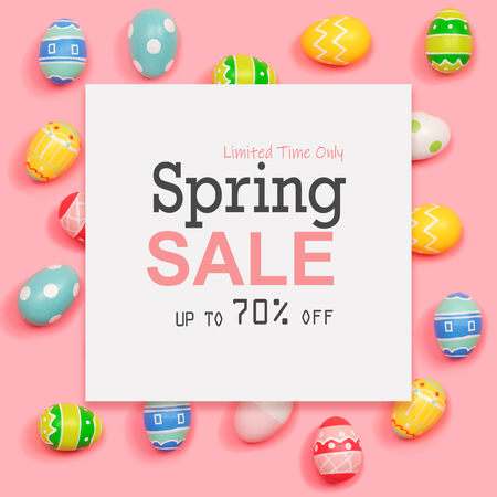 Spring sale message with Easter eggs on a pink background Stock Photo