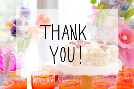 Thank you message with dessert table with cupcakes and flowers
