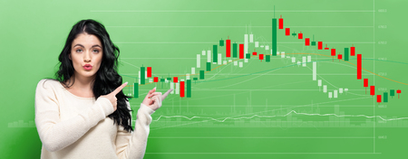 Stock market candle chart with young woman pointing on a green background Zdjęcie Seryjne