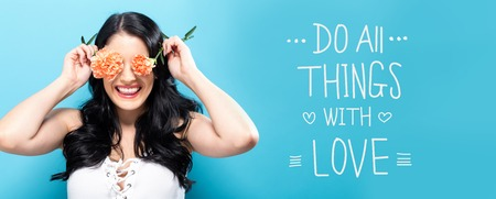 Do all things with love message with young woman holding carnation flowers