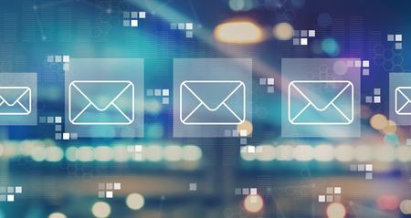 Emails with blurred city abstract lights background Banco de Imagens