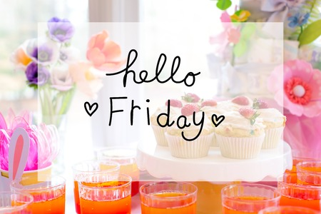 Hello Friday message with dessert table with cupcakes and flowers