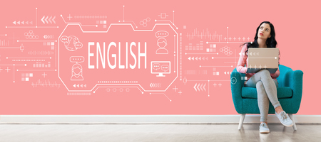 English concept with young woman using a laptop computer Stock Photo