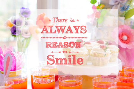 There is always a reason to smile with dessert table with cupcakes and flowers Stock Photo
