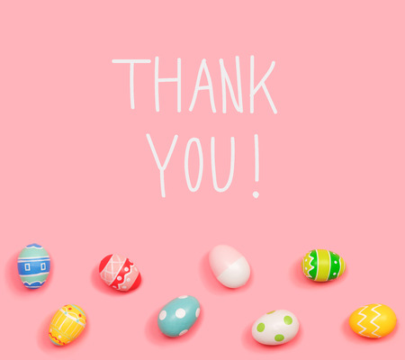 Thank you message with Easter eggs on a pink background