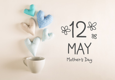 Mothers Day message with blue heart cushions coming out of a coffee cup