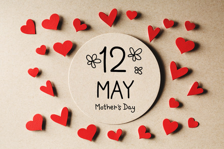 12 May Mothers Day message with handmade small paper hearts Stock Photo - 120933753