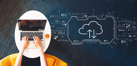 Cloud computing with person using a laptop on a white table Stock fotó