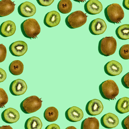 Square frame of kiwi fruits overhead view flat lay Stock Photo