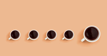 One out unique coffee cup concept overhead view flat lay Stock Photo