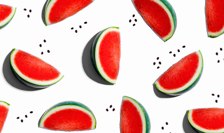 Sliced watermelons arranged on a white background Фото со стока