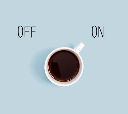 Coffee with power on switch overhead view flat lay Фото со стока