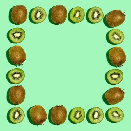 Square frame of kiwi fruits overhead view flat lay Фото со стока