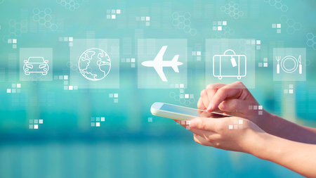 Airplane travel theme with person holding a white smartphone Фото со стока