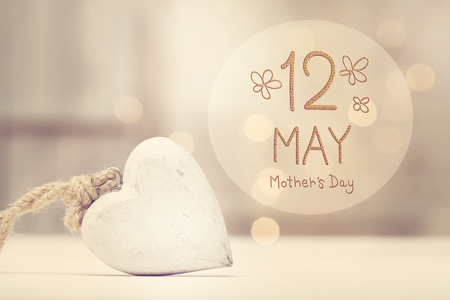 Mothers Day message with a white heart  in a room