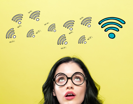 WiFi theme with young woman wearing eye glasses Stock Photo