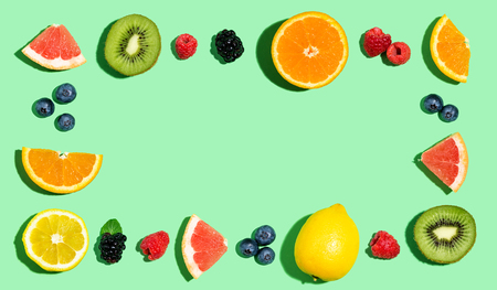 Rectangular frame of mixed fruits overhead view flat lay
