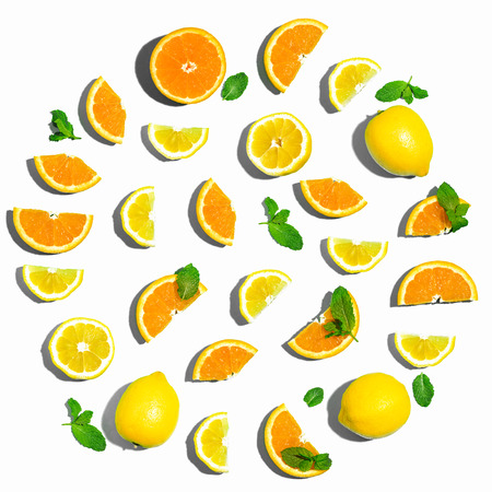 Collection of oranges and lemons overhead view flat lay Фото со стока