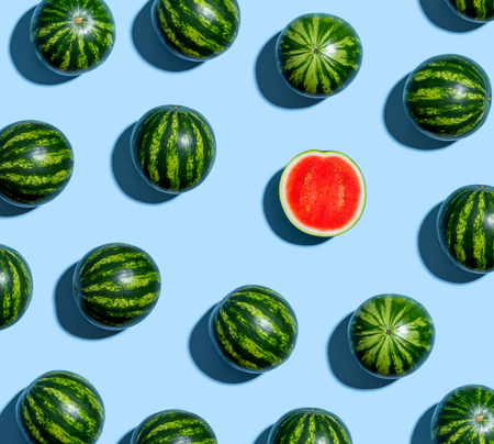 One out unique watermelons arranged on a blue background Фото со стока