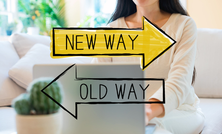 Old way or new way with woman using her laptop in her home office
